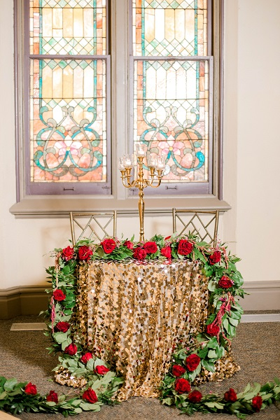 Sweetheart table with flower garland