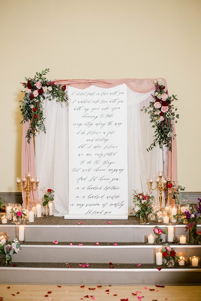 Ceremony arbor with florals and candles